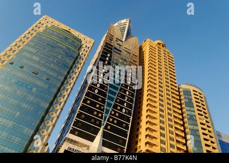 Multistory buildings on the corniche of Sharjah City, Emirate of Sharjah, United Arab Emirates, Arabia, Near East - Stock Photo