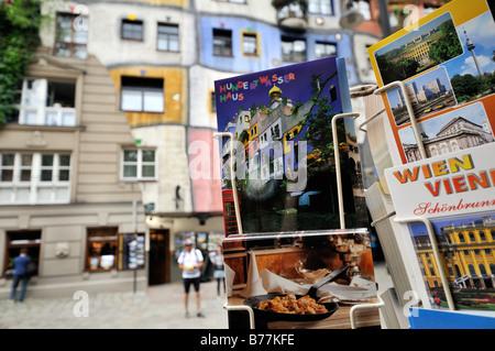 Postcard stand in front of Hundertwasserhaus, Vienna, Austria, Europe - Stock Photo