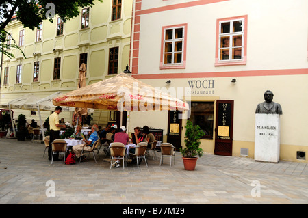 Tourists in a café in front of the old city hall, Stará radnica, Bratislava, former Pressburg, Slovakia, Europe - Stock Photo