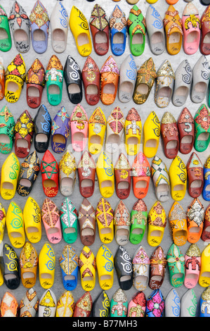 Typical Moroccan slippers as fridge magnets in a souvenir shop at Place Djemma el-Fna, Square of the Hanged, Square - Stock Photo