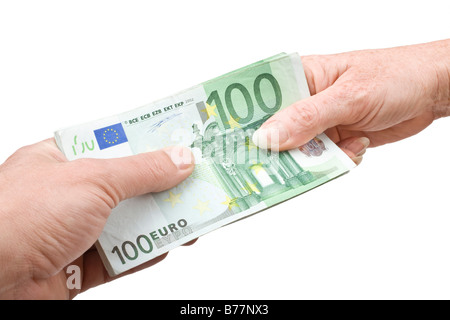 100 euro bill being handed over, hands of a man and a woman - Stock Photo