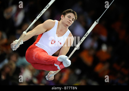 Nicolas Boeschenstein, Switzerland, performing an L-sit on the rings, Gymnastics World Cup Stuttgart 2008, Baden - Stock Photo
