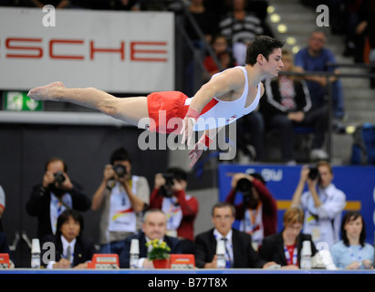 Nicolas Boeschenstein, Switzerland, performing on the floor in front of the judges and press photographers, Gymnastics - Stock Photo
