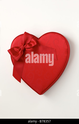 Heart box of candy valentine red heart white background cut out red bow gift chocolates - Stock Photo