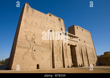 The First Pylon and outer walls at Edfu Temple Egypt - Stock Photo