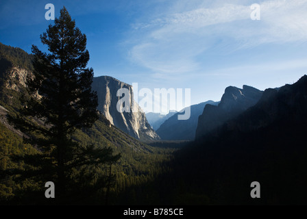 View of YOSEMITE VALLEY showing EL CAPITAN and HALF DOME YOSEMITE NATIONAL PARK CALIFORNIA - Stock Photo