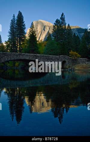 HALF DOME is reflected in the MERCED RIVER during the fall season YOSEMITE NATIONAL PARK CALIFORNIA - Stock Photo