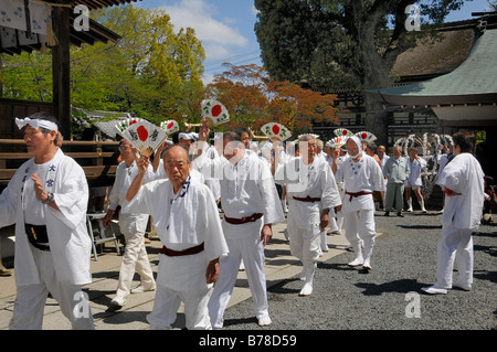 Handles of the shrines being carried accompanied by waving fans, Matsuri Shrine Festival of the Matsuo Taisha Shrine, - Stock Photo