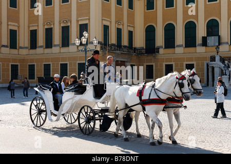 Hackney carriage, fiaker in front of Schloss Schoenbrunn, Schoenbrunn Castle, Vienna, Austria, Europe - Stock Photo