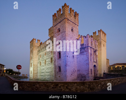 The colourfully illuminated Scaliger Castle in the evening, Castello Scaligero, commune of Sirmione, Lake Garda, - Stock Photo