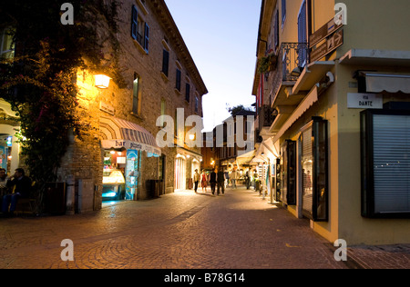 Historic district of Sirmione at the Scaliger Castle in the evening, Castello Scaligero, commune of Sirmione, Lombardy, - Stock Photo