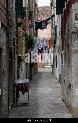Italy, Venice, Clotheslines in lane - Stock Photo