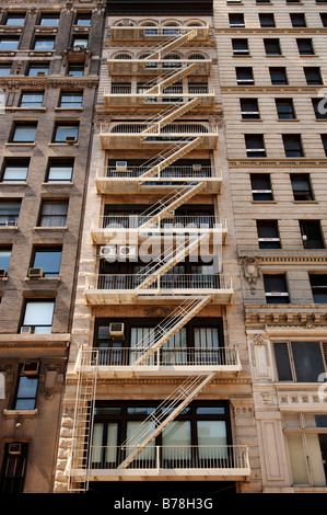 Fire escape stairs on a high rise, New York City, USA, North America - Stock Photo