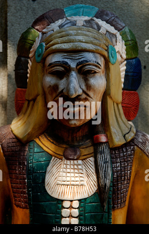 Figure of an American Indian in front of a store, New York City, USA - Stock Photo