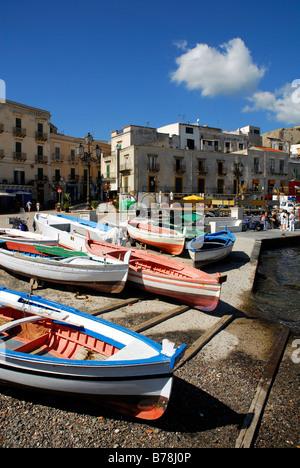 Small fishing boats and houses in the port of Marina Corta in the city of Lipari on Lipari Island, Aeolian or Lipari - Stock Photo