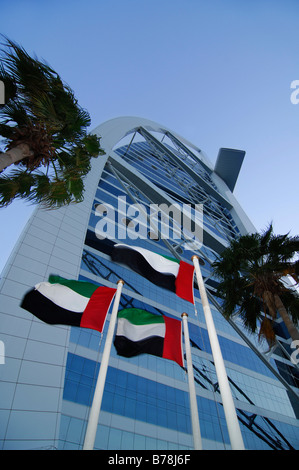 United Arab Emirates flags outside the Burj al Arab, deluxe hotel in Dubai, United Arab Emirates, UAE, Middle East - Stock Photo
