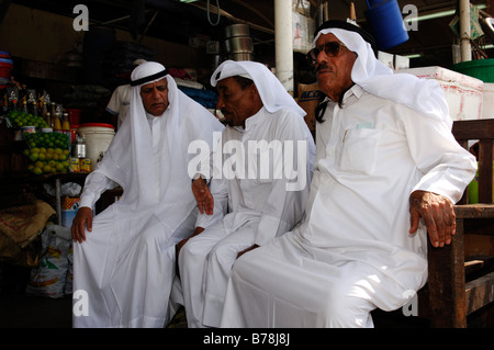 Old men at the market in Deira, Dubai, United Arab Emirates, UAE, Middle East - Stock Photo