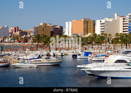 Boats in Club Nautic s'Arenal, marina, in front of buildings on the Boulevard of Arenal, Majorca, Balearic Islands, - Stock Photo