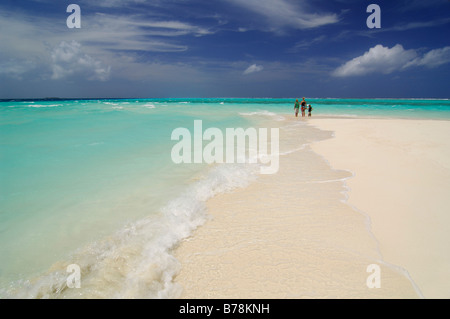 Woman and two children on the beach, Laguna Resort, The Maldives, Indian Ocean - Stock Photo