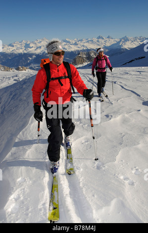 Ski mountain climbers, Les Diableretes, skiing area Glacier 3000, Gstaad, West Alps, Bernese upper country, Switzerland, - Stock Photo