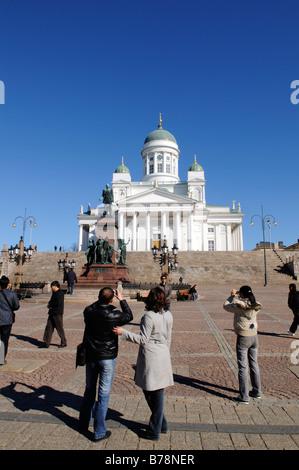 Alexander II statue, Tuomiokirkko, Helsinki Cathedral, people on Senate Square, Helsinki, Finland, Europe - Stock Photo