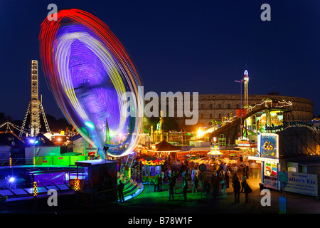 Carousel, autumn folk festival, springtime festival in the evening on the Nazi party rally grounds in front of congress - Stock Photo