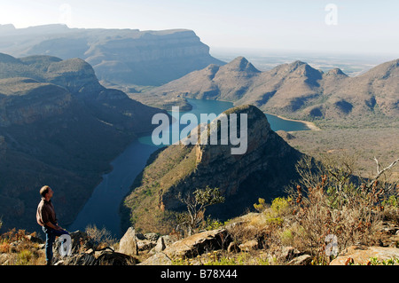 Man looking toward Blyde River Canyon and reservoir Blyderivierspoort Dam, Mpumalanga, South Africa, Africa - Stock Photo