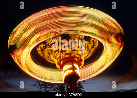 SWIRLING COLORS OF RIDE AT VALLEYFAIR AMUSEMENT PARK, SHAKOPEE, MINNESOTA (NEAR MINNEAPOLIS) AT DUSK. - Stock Photo