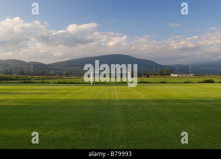 empty goal post at soccer field in a rural setting. - Stock Photo