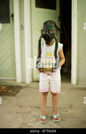 Five year old girl wears gas mask - Stock Photo