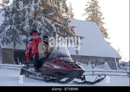 Snowmobile ride on Gubalowka Hill Zakopane Tatra Mountains Podhale Region Poland - Stock Photo