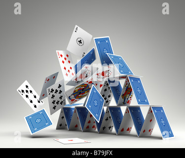 photorealistic 3D render of a House of cards collapsing - Stock Photo