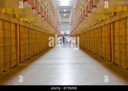 Cells and moving tourists in Alcatraz Penitentiary San Francisco USA - Stock Photo