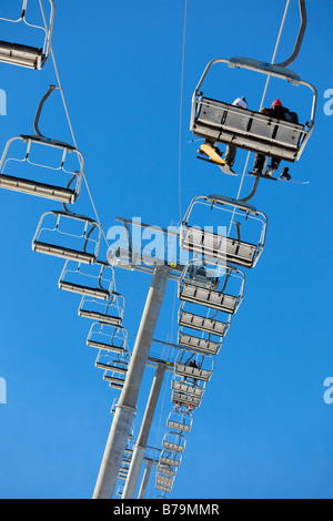 people on ski lift Low angle view - Stock Photo