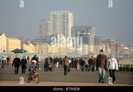 Brighton and Hove city tower blocks rise above the busy promenade on a winters afternoon - Stock Photo