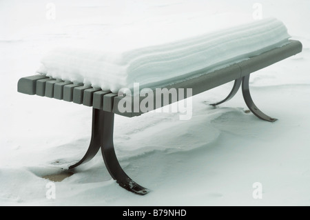 Yellow tennis ball on bench by tennis court - Stock Photo