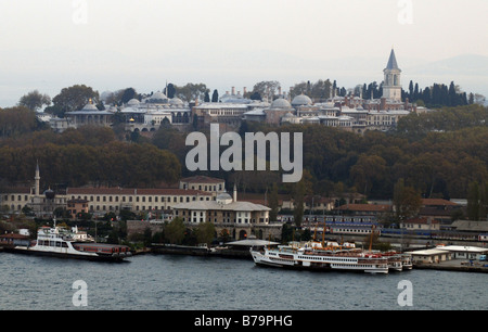 Topkapi Palace stands above the ferries in Istanbul, Turkey. - Stock Photo