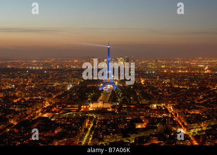 Aerial photograph Paris by night with Eiffel Tower, Champ de Mars, Ecole Militaire and La Defense, Paris, France, - Stock Photo
