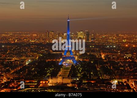 Aerial photograph Paris by night with Eiffel Tower, Champ de Mars, Ecole Militaire and La Defense, Paris, France, - Stock Photo