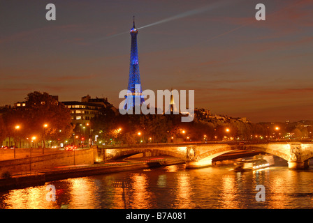 Illuminated Seine bridge and Eiffel Tower by night, Paris, France, Europe - Stock Photo