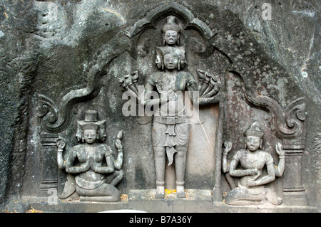 Hinduism, ancient stone relief, Great Trinity or Trimurti with the three deities Brahma, Shiva and Vishnu, from - Stock Photo
