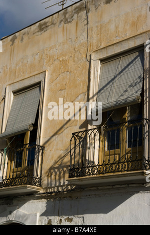 Rustic Wooden Doors Small Balconies On Old Houses Spain - Stock Photo