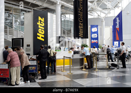 Car Rental Desks of the Hertz and Budget car rental companies in the Munich Airport, Bavaria, Germany, Europe - Stock Photo