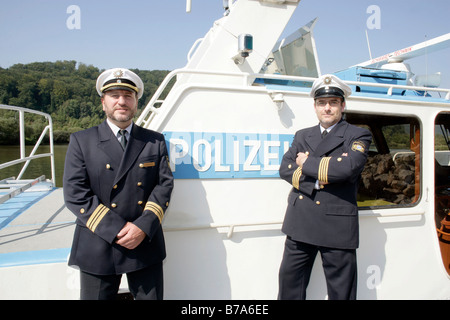 Harbor Patrol police officers, Wasserschutzpolizei Beilingries on patrol boat WSP 50 on the Rhine-Main-Danube Canal - Stock Photo