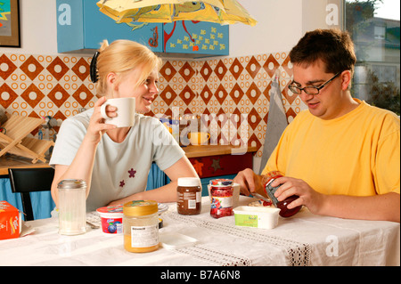 Young couple having breakfast - Stock Photo