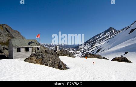 Alpinist shelter on the summit, Canadian flag, Chilkoot Pass/Trail, Klondike Gold Rush, British Columbia, B.C., - Stock Photo