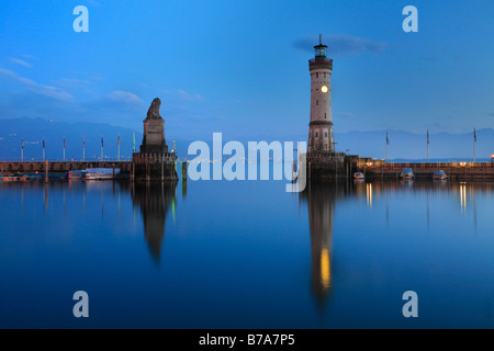 The Bavarian lion and the new lighthouse built in 1856 in Lindau at Lake Bodensee, Swabia, Bavaria, Germany, Europe - Stock Photo
