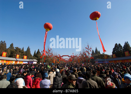 Crowd waiting for Temple of Earth Chinese New Year fair in Beijing China - Stock Photo