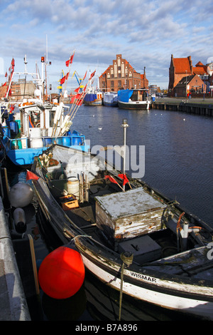 Fishing boats in the old harbour of Wismar on the Baltic Sea coast, UNESCO World Heritage Site, Hanseatic League - Stock Photo