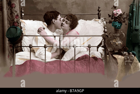 Historic photo, loving couple in bed, ca. 1910 - Stock Photo